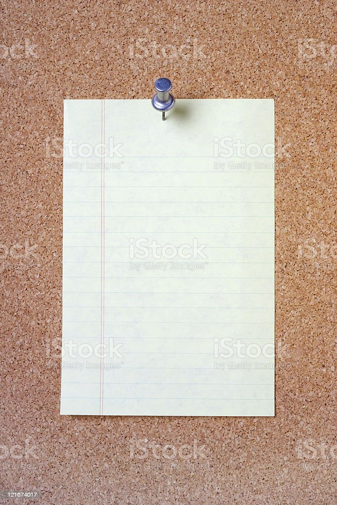 Lined paper on Cork Board royalty-free stock photo