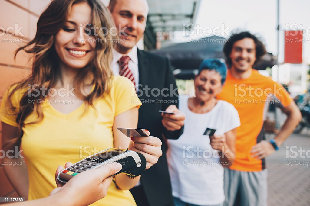 Lined up for contactless payment stock photo