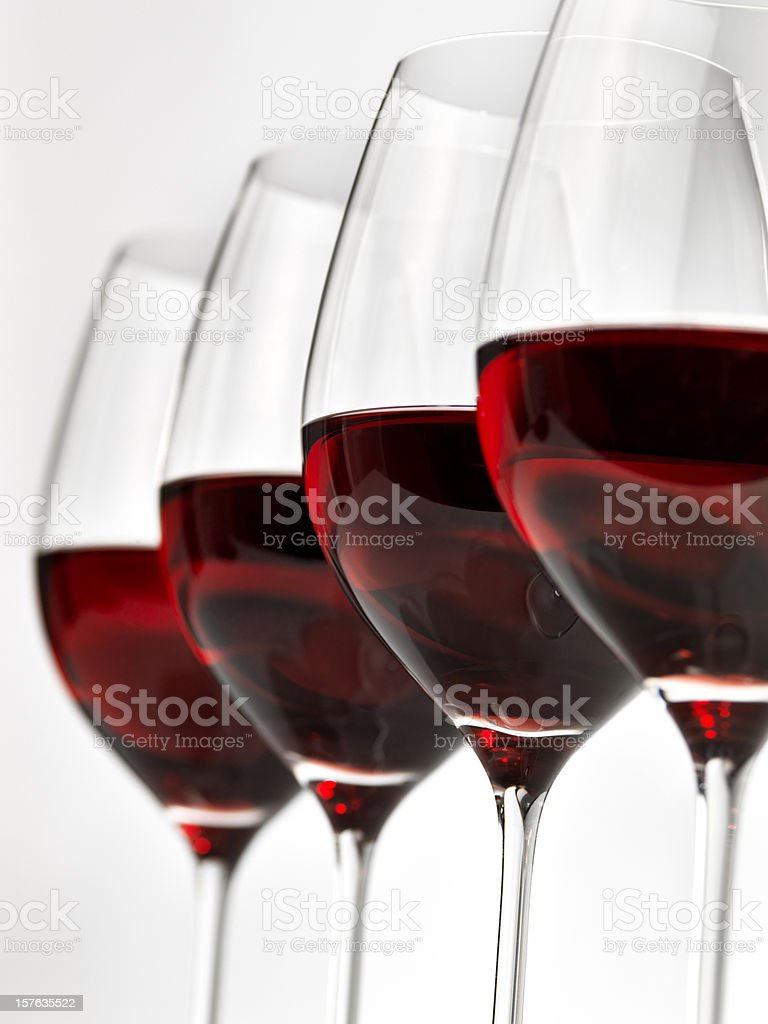 Lined up row of glasses of red wine royalty-free stock photo