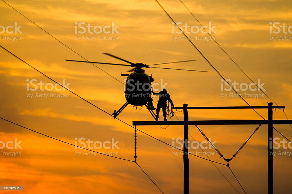 Lineman Getting in Helicopter stock photo