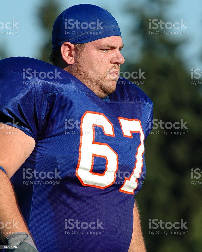 Lineman in skull cap stock photo