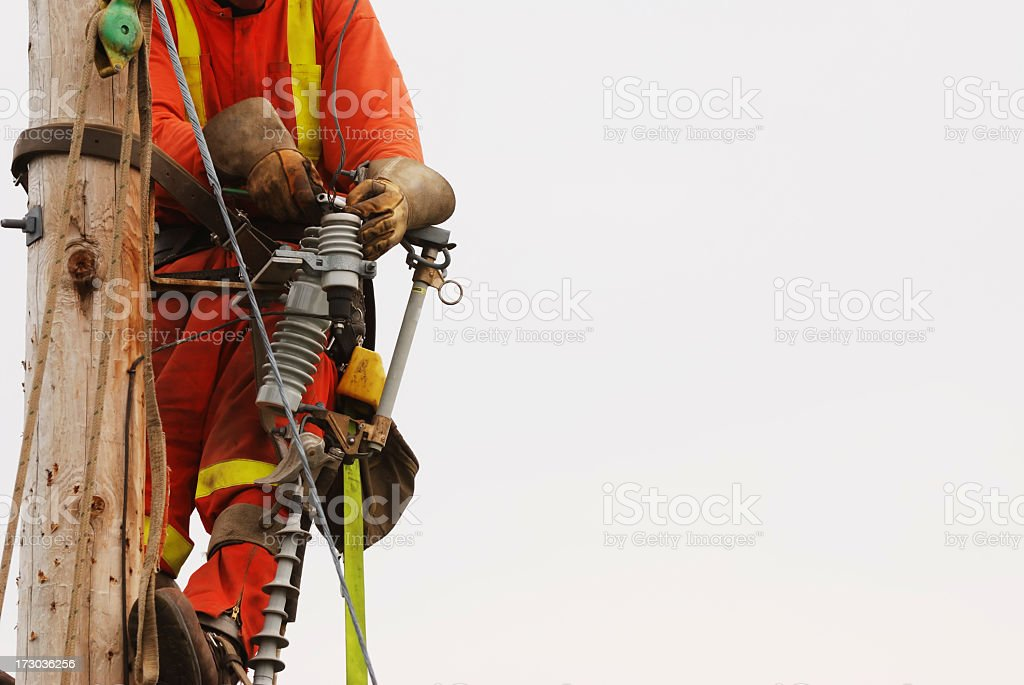 Lineman Up a pole fixing the wires. royalty-free stock photo