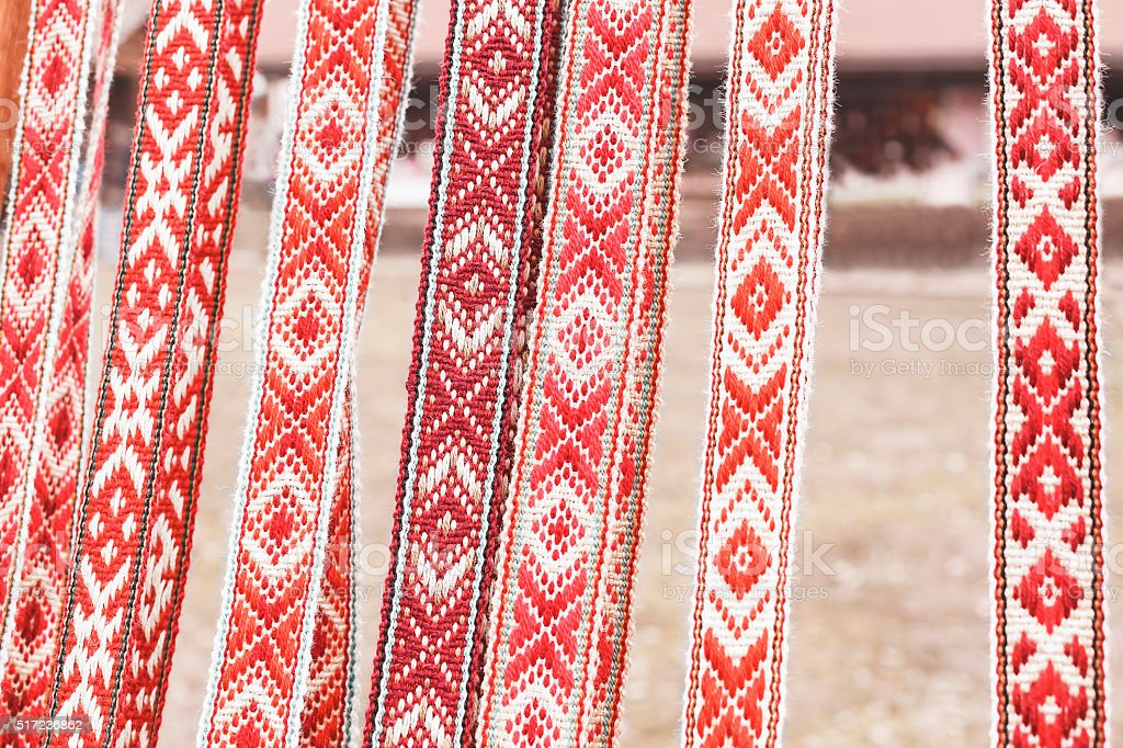 linen belt with ornaments that hang in a row stock photo