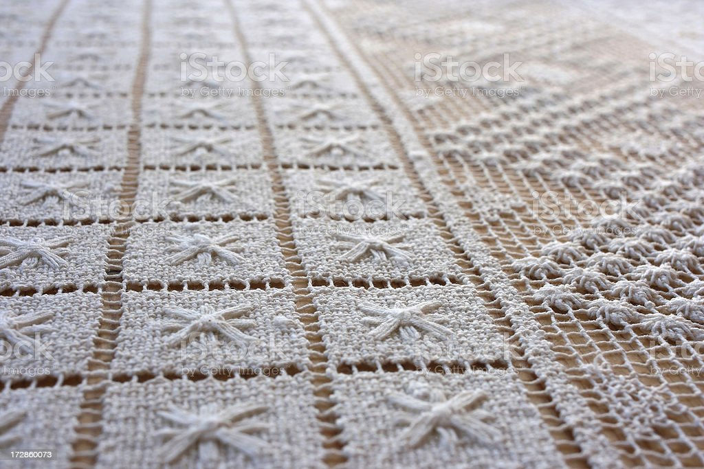 Linen Doily with square and star patterns royalty-free stock photo
