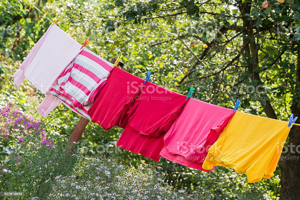 Linen is dried on rope in the garden stock photo