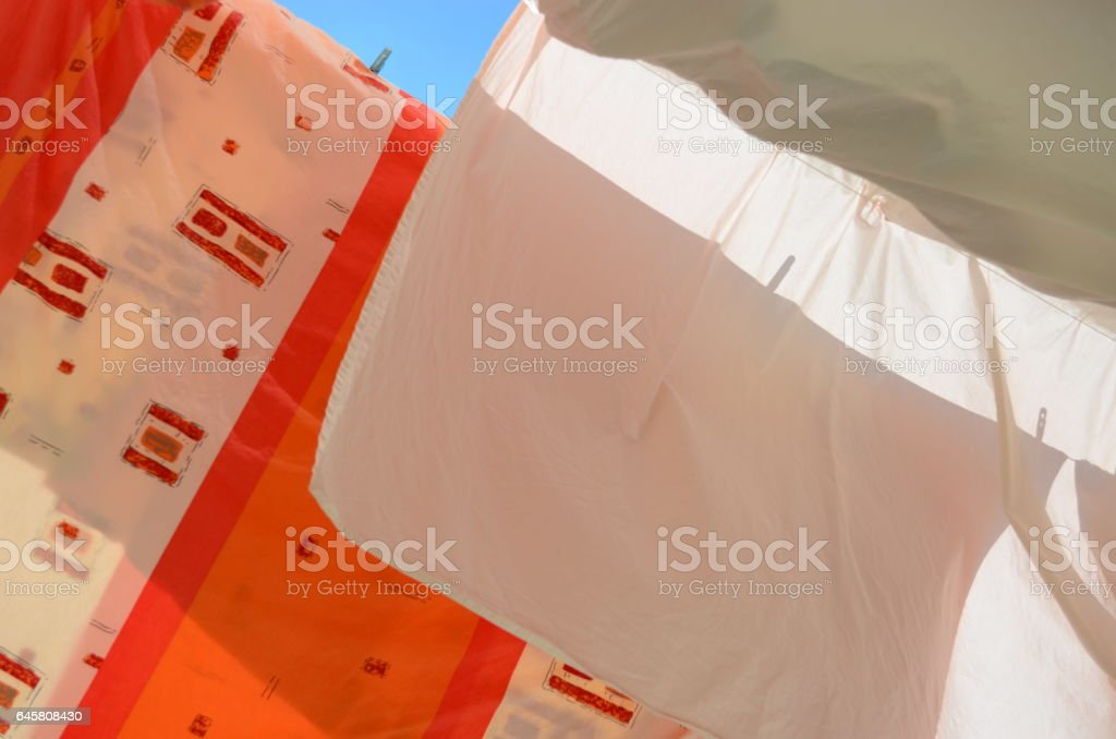 Linen on a balcony, drying. stock photo