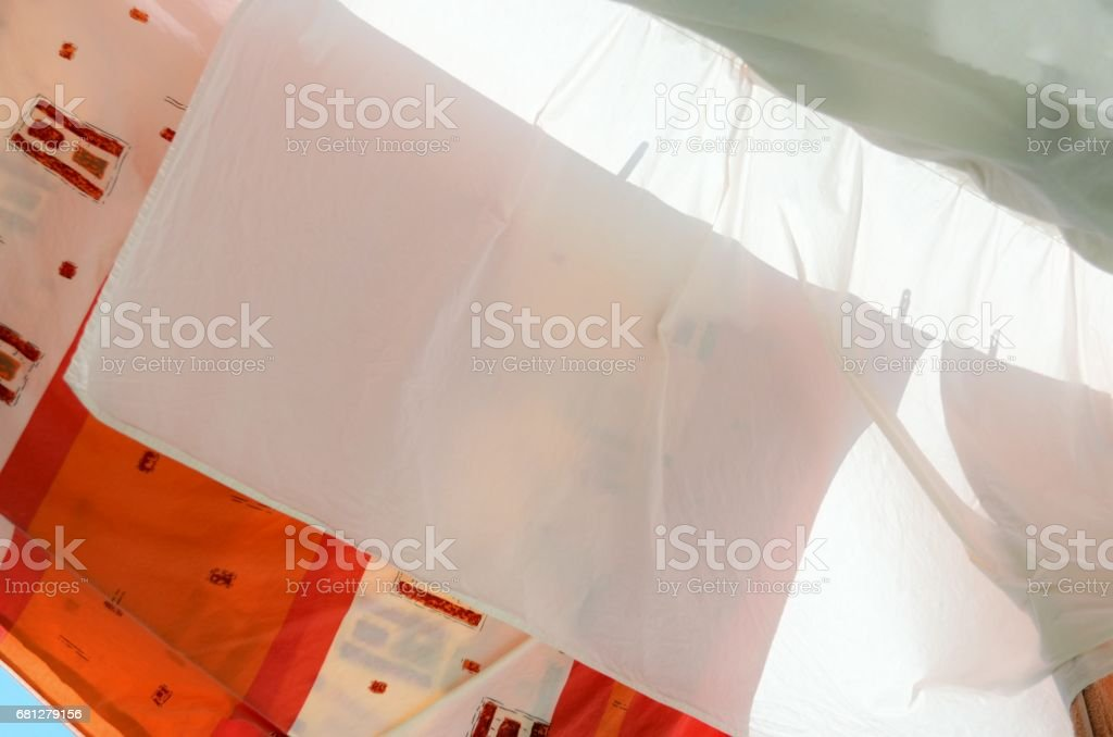 Linen on a rope. Drying process. stock photo