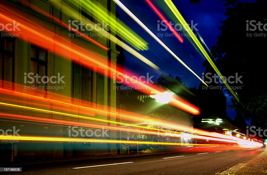 Lines of blurred light along road at night royalty-free stock photo