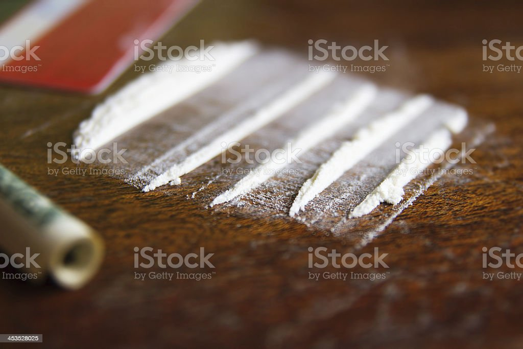 Lines of cocaine on the table royalty-free stock photo