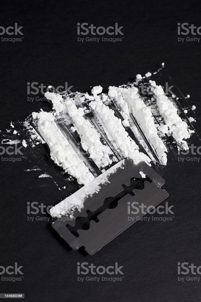 Lines of Cocaine with a Razor Blade stock photo