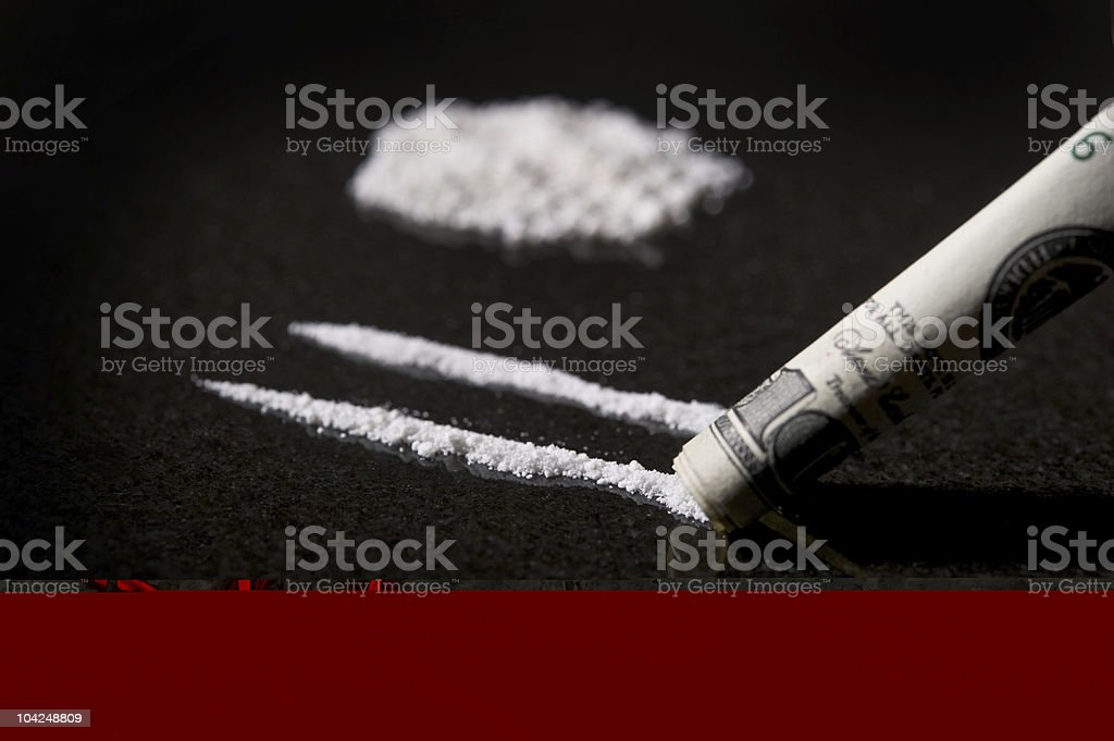 Lines of Cocaine with rolled bill royalty-free stock photo