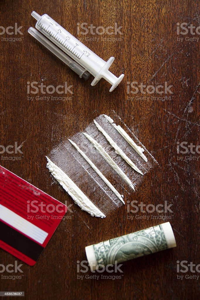 Lines of cocaine,syringe,credit card and dollar royalty-free stock photo