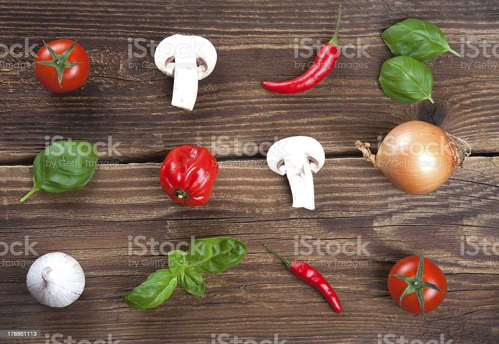 Lines of fresh vegetables and herbs on old wood royalty-free stock photo
