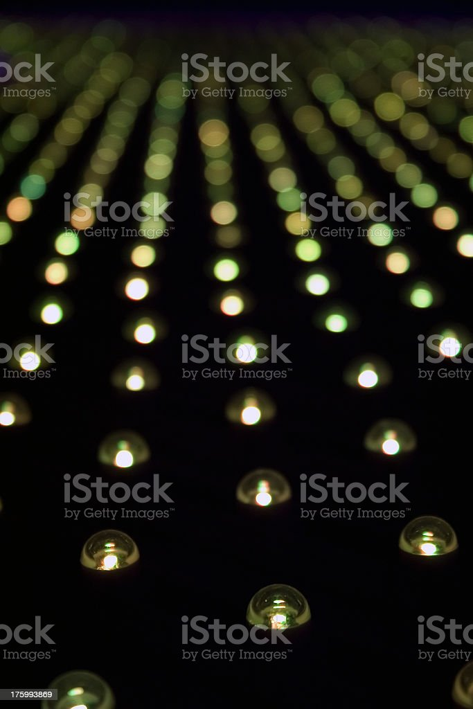 Lines of round yellow leds stock photo