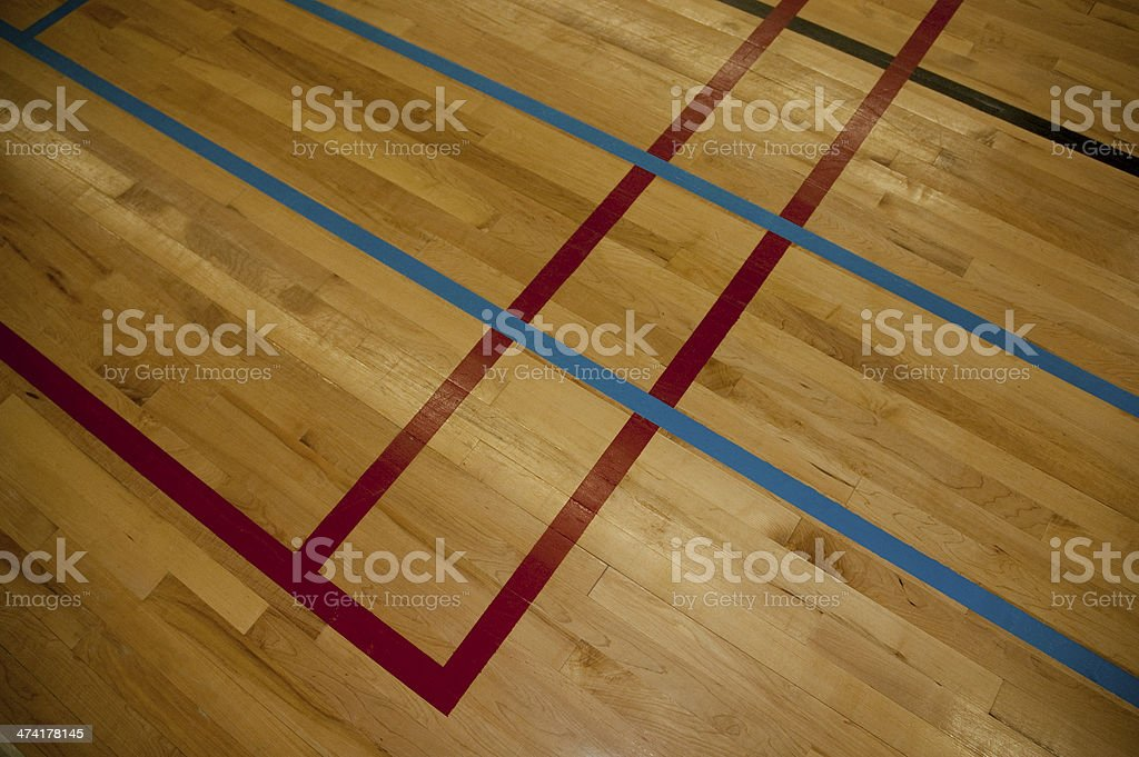 Lines on a hardwood gym floor royalty-free stock photo