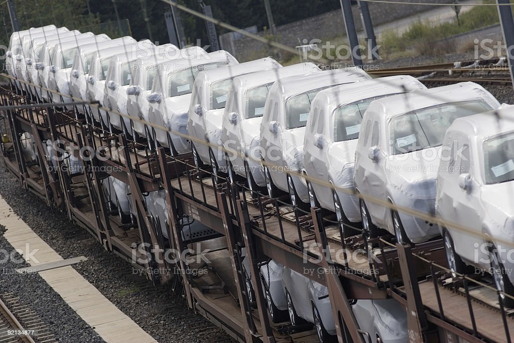 A line-up of brand new cars in an automobile factory stock photo