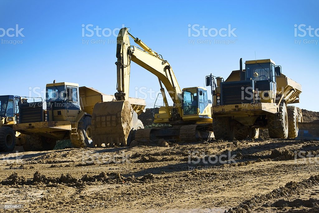 Lineup of Construction Trucks On a Clear Sunny Day stock photo