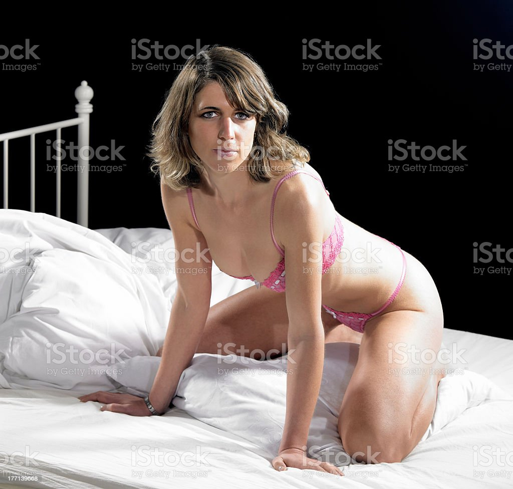 lingerie dressed woman on bed stock photo