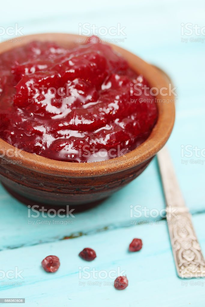 Lingonberry sauce to meat dishes stock photo