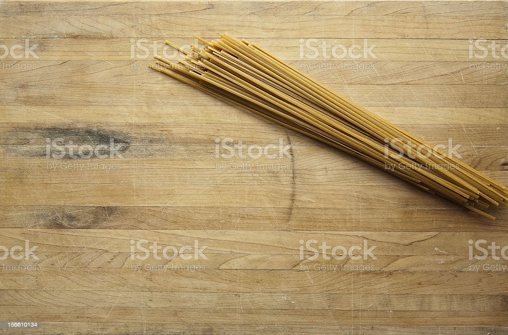 Linguine on a Worn Butcher Block Cutting Board stock photo