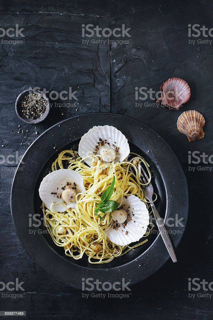 Linguine pasta with scallops stock photo