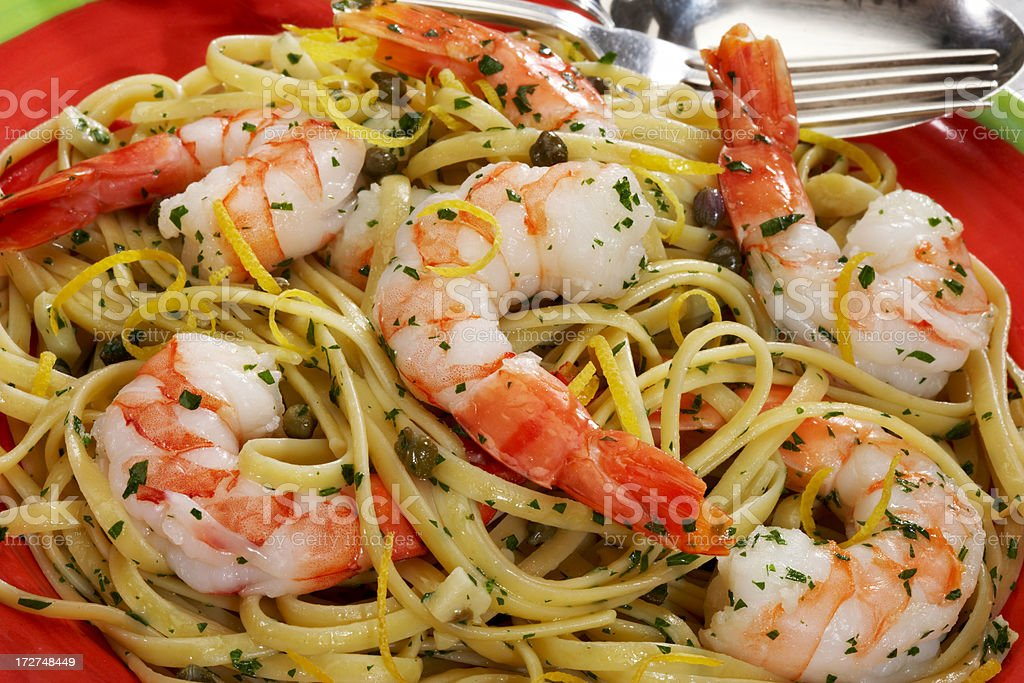 Linguine with shrimp and capers stock photo