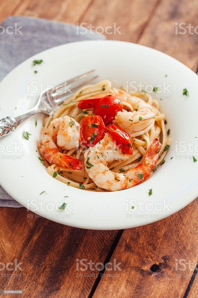 Linguini Pasta with Jumbo Tiger Prawns stock photo