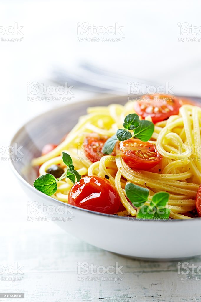Linguini with cherry tomatoes and herbs stock photo