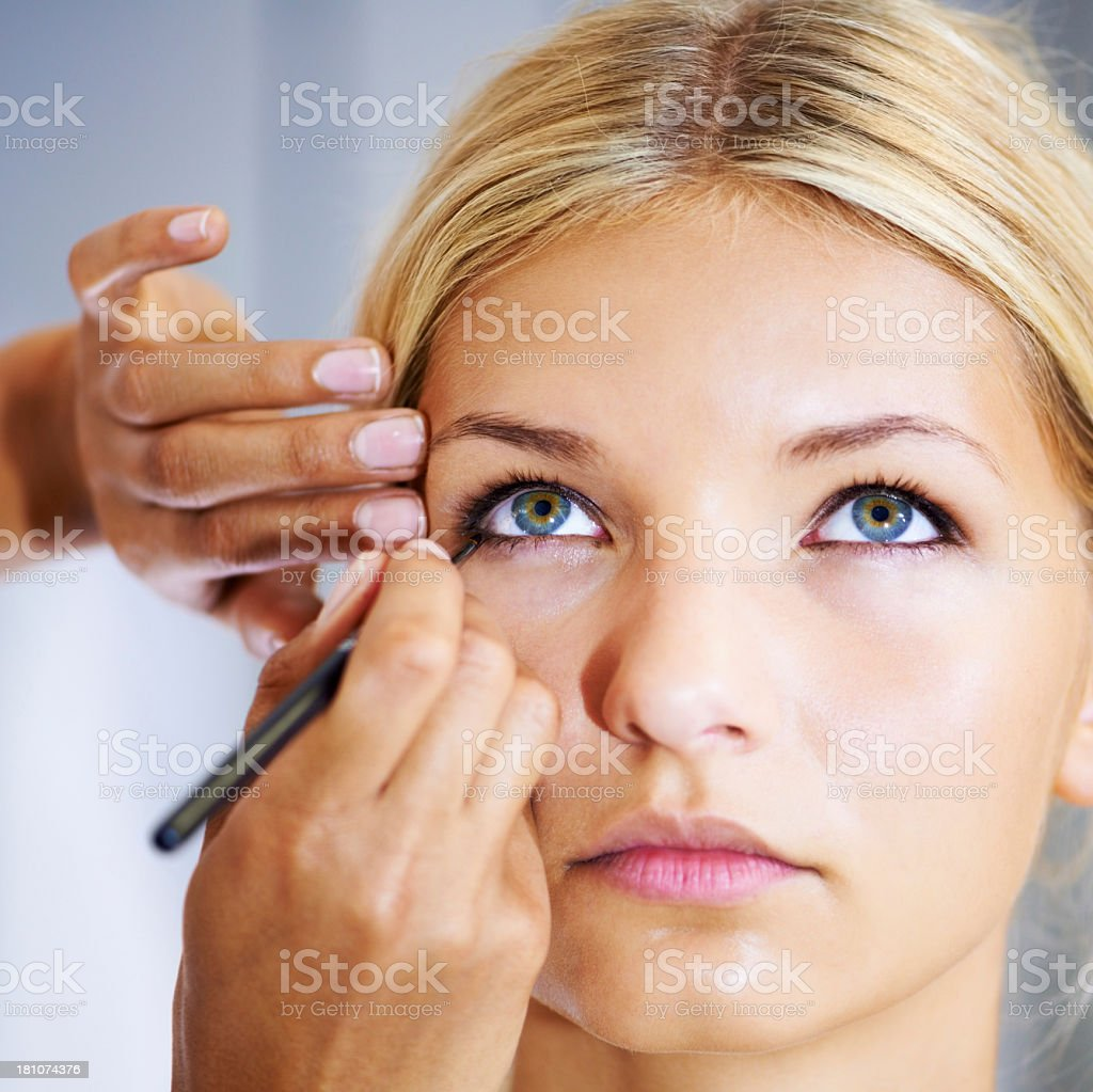 Lining the eye for a dramatic finish royalty-free stock photo