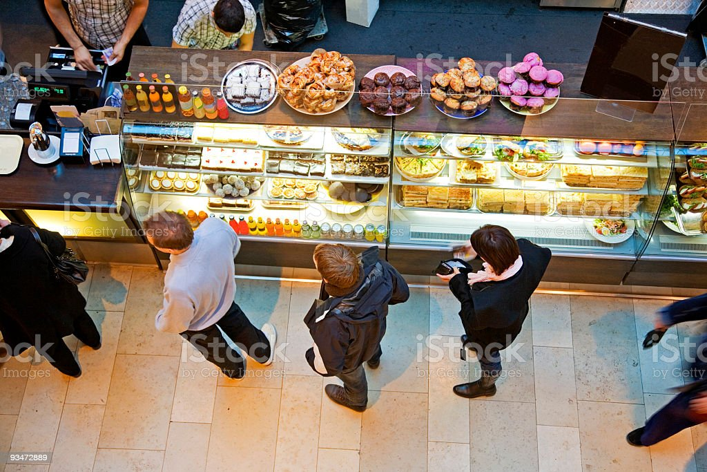 Lining up at cafe' with tasty pastry for a snack. royalty-free stock photo