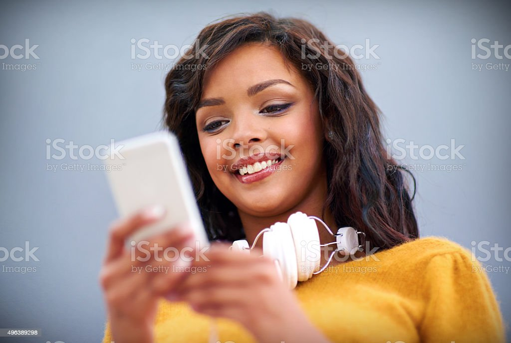 Lining up the perfect playlist for a jam session stock photo