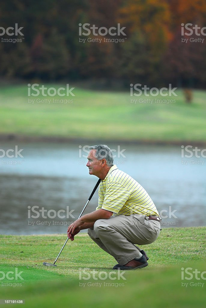 Lining up the Putt royalty-free stock photo