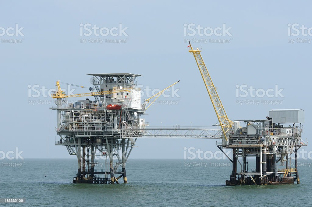 Linked offshore natural gas production platforms royalty-free stock photo