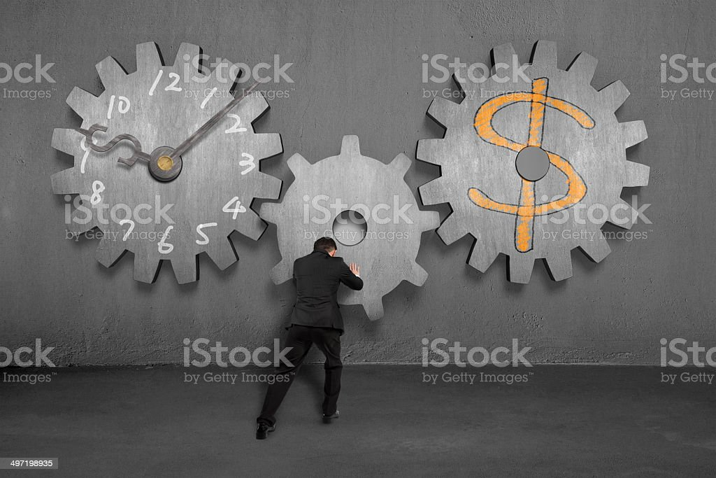 Linking concrete gears for time is money concept stock photo