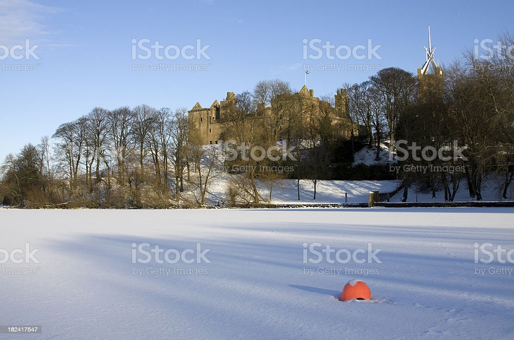 Linlithgow Palace viewed over a frozen loch at winter. stock photo