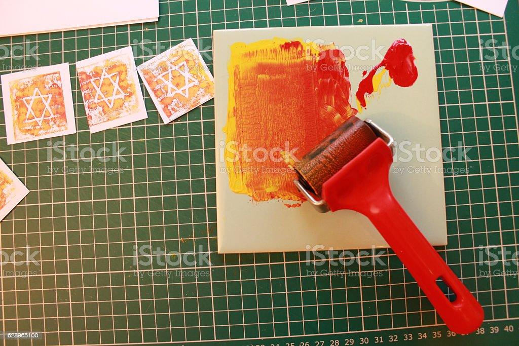 Lino printing for Christmas stars stock photo