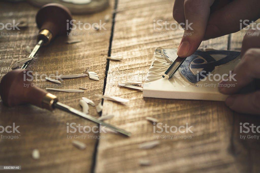 Linocut carving stock photo
