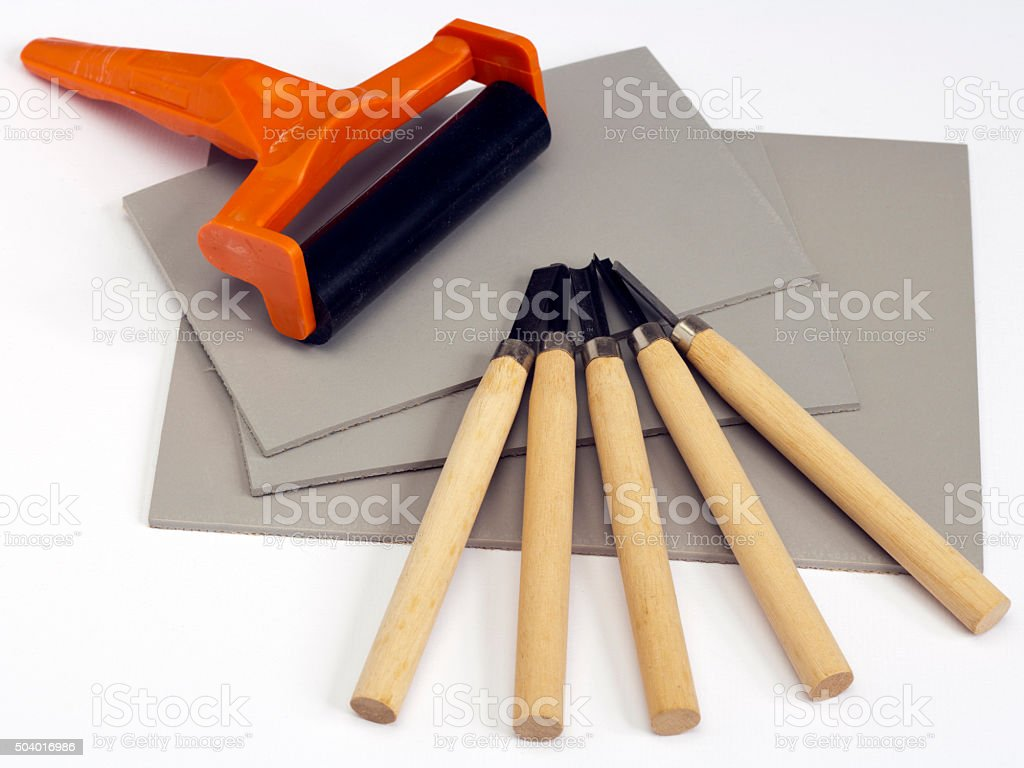Linocut materials and tools stock photo