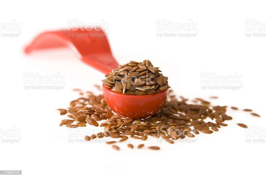 Linseed in a small measuring spoon royalty-free stock photo