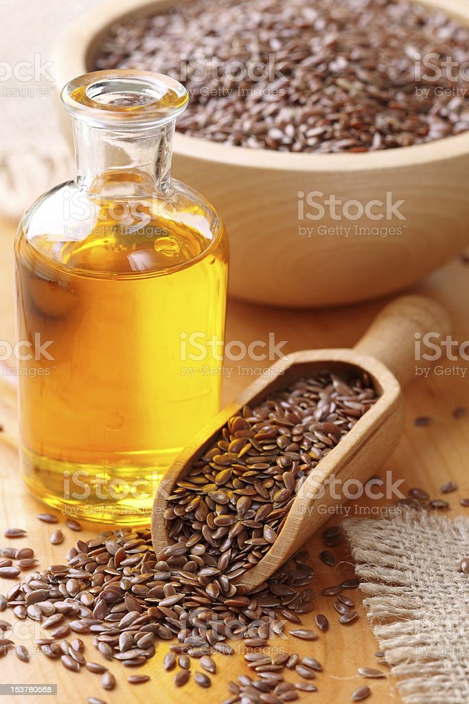 Linseed oil and flax seeds stock photo