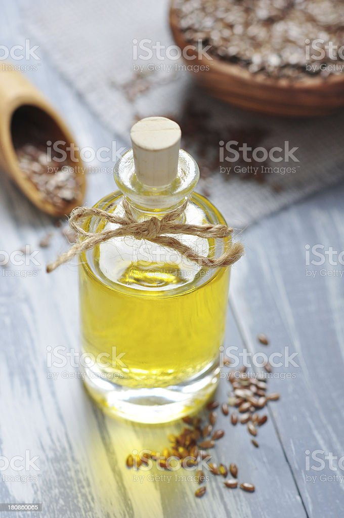 Linseed oil and flax seeds royalty-free stock photo