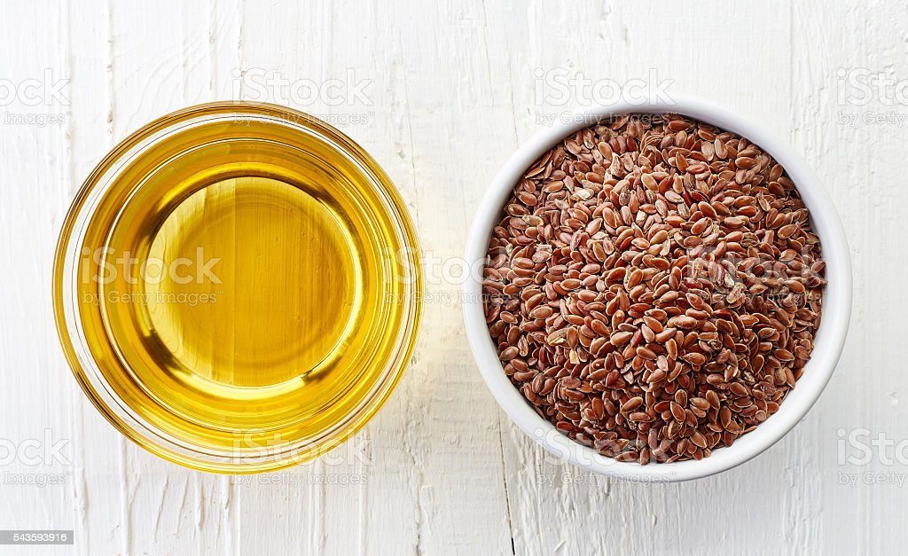 Linseed oil and linseeds stock photo