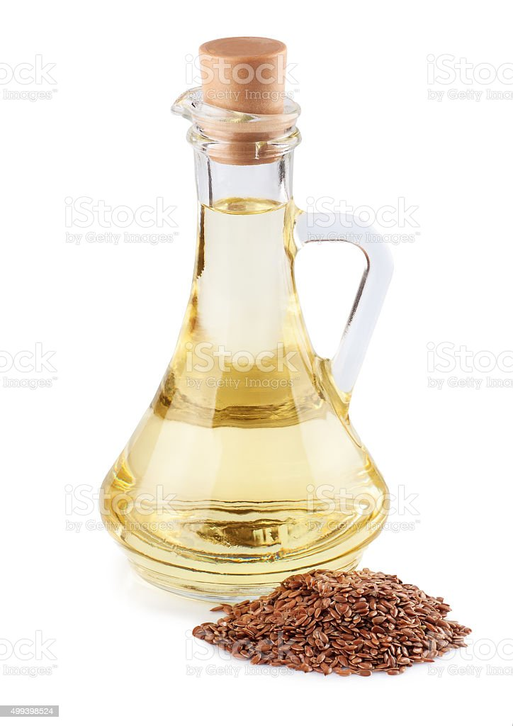 Linseed oil in a glass jug stock photo