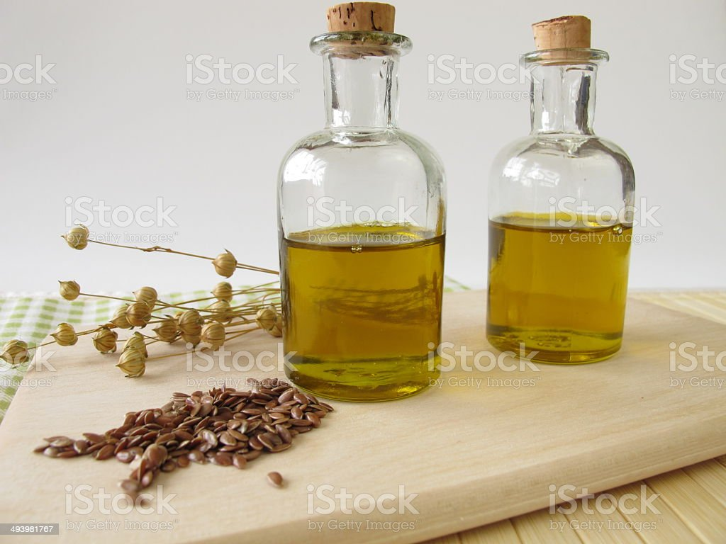 Linseed oil in small bottles stock photo