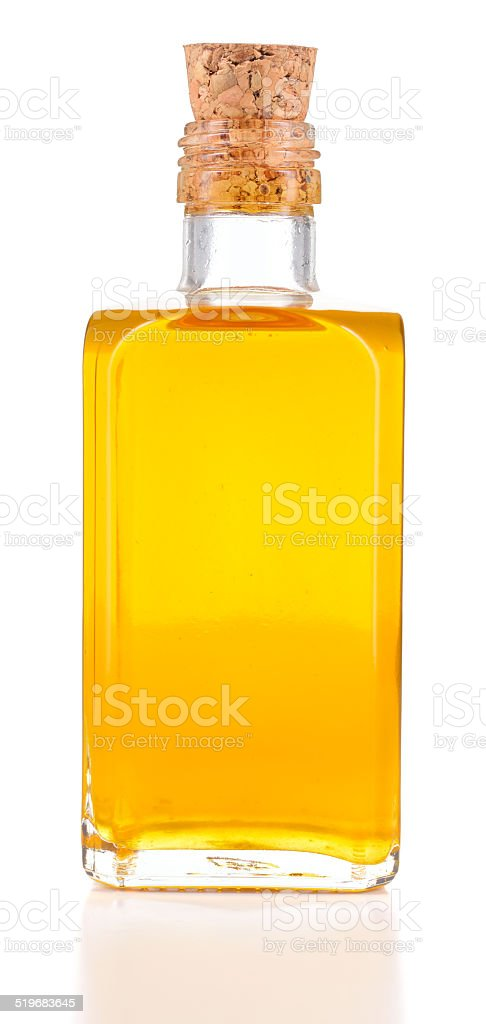 Linseed oil or flaxseed oil in a bottle isolated. stock photo