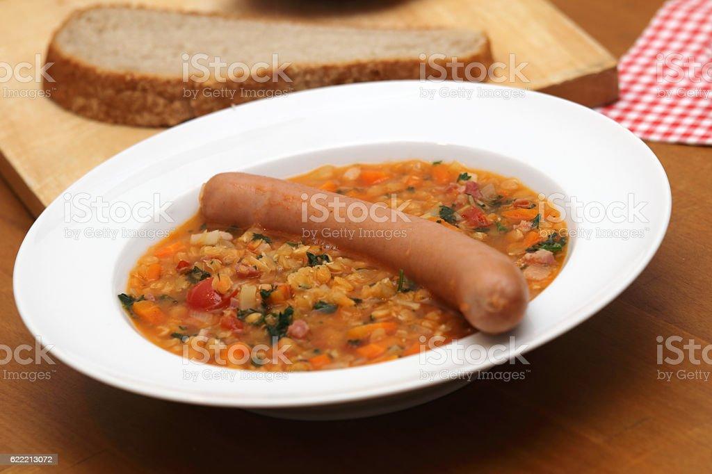 Linseneintopf mit Wiener Würstchen stock photo