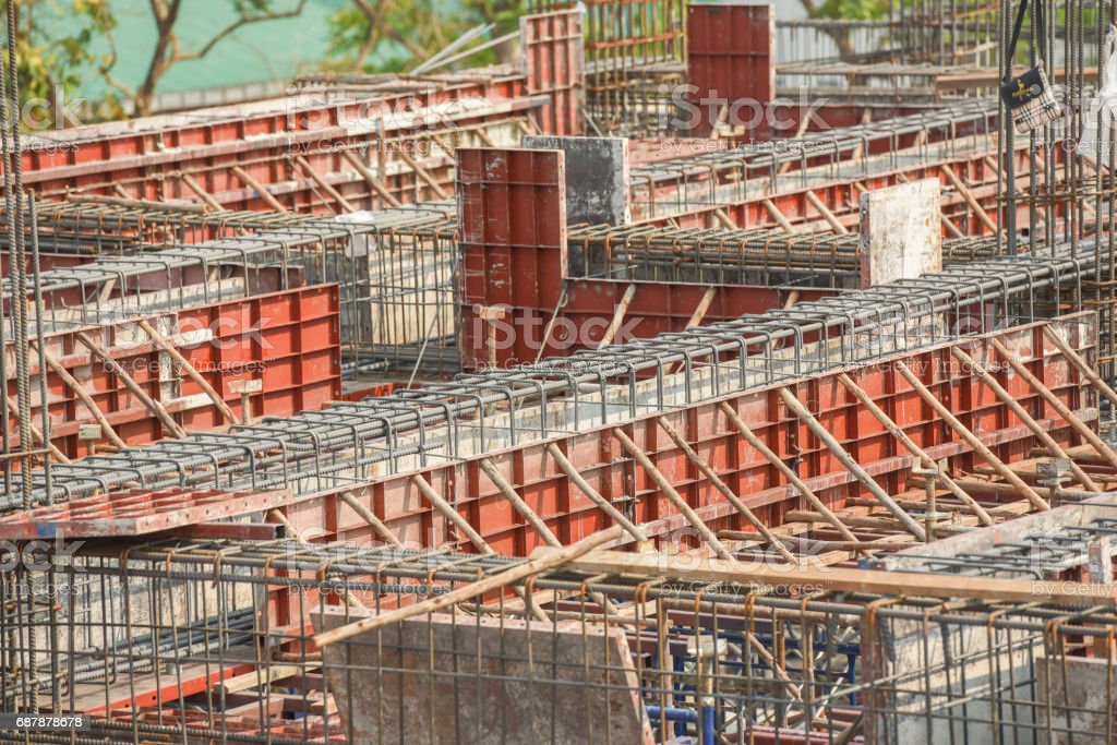 Lintel Construction. Rebar steel bars on new home construction corner reinforcement concrete bars with wire rod as a lintel for window. stock photo
