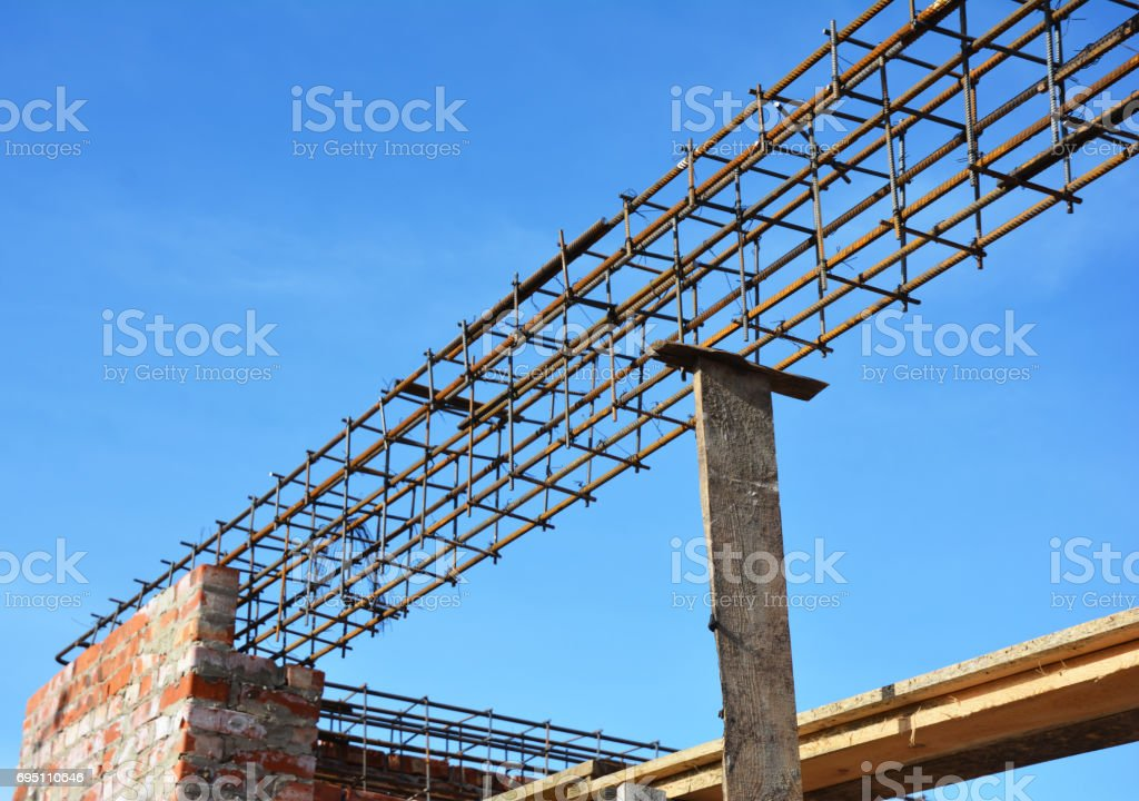 Lintel Construction. Rebar steel bars on new home construction corner, reinforcement concrete bars with wire rod as a lintel for window. stock photo
