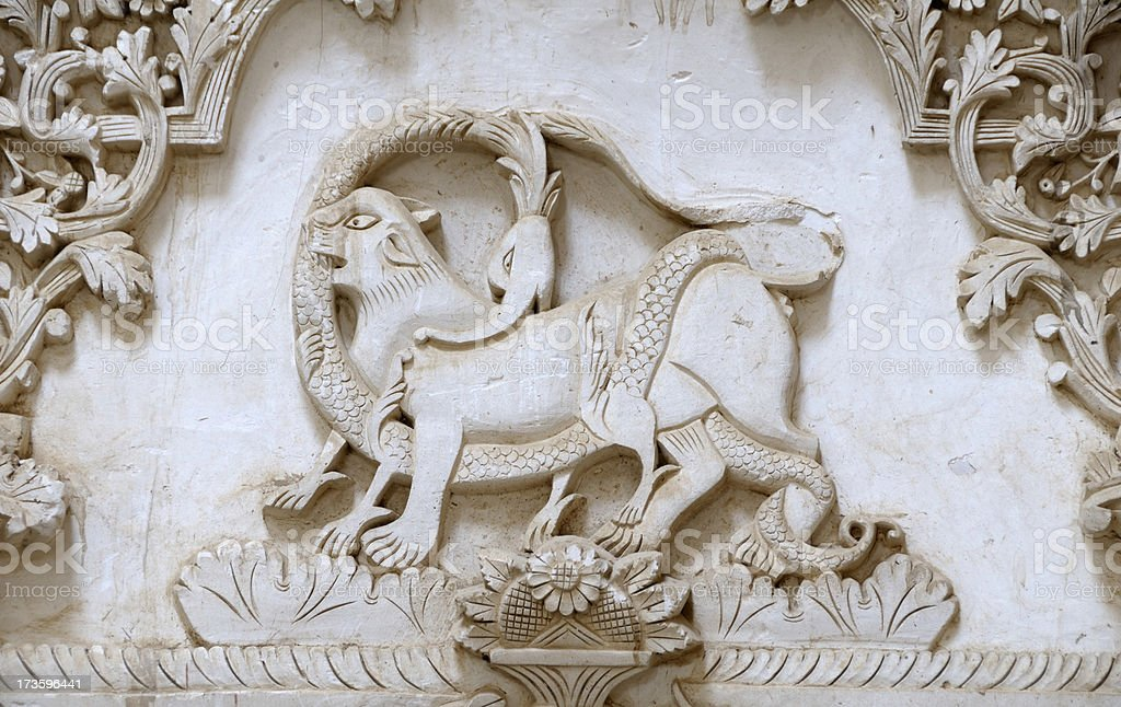 Lion and Snake Relief on the Wall of Boroujerdi House stock photo