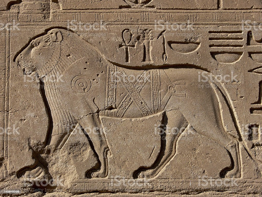 Lion basrelief and hieroglyphs royalty-free stock photo